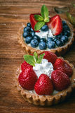 Desserts on wooden table Royalty Free Stock Images