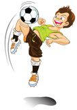 Dessin animé de garçon jouant au football Photographie stock