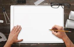 Dessin d'architecte sur le livre blanc vide Photos stock
