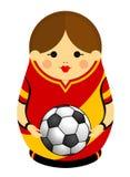 Dessin d'un Matryoshka avec des couleurs du drapeau de l'Espagne tenant un ballon de football dans des ses mains Poupée russe d'e Photos stock