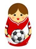 Dessin d'un Matryoshka avec des couleurs du drapeau du Pérou tenant un ballon de football dans des ses mains Poupée russe d'emboî Photographie stock libre de droits
