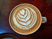 Dessin dans la tasse de coffe Photos stock
