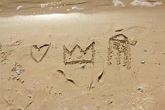 Dessin dans le sable Photos stock