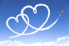 Dessin de concept de nuage d'amour par le jet Photos stock