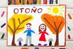 Dessin : Mot espagnol AUTOMNE, couple de sourire et arbres Images stock