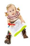 Dessin préscolaire de fille sur un conseil Photo stock
