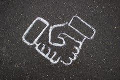 Dessin simple blanc d'affaires sur la craie d'asphalte Photos stock