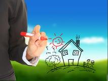 Dessinez une maison avec un crayon lecteur Image stock
