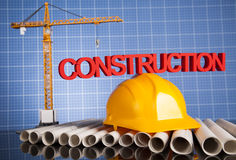 Dessins, bâtiment et grues de projet en construction Photographie stock