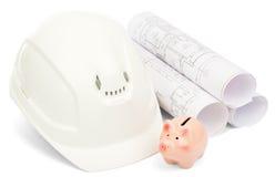 Dessins pour la maison de construction, la tirelire et le casque Images stock