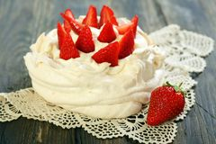 Desssert Pavlova with strawberries. Royalty Free Stock Photography