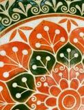 Dessus de table en pierre peint coloré orange et vert-foncé vif images stock
