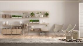 Dessus ou étagère de table en bois de vintage avec les bougies et les cailloux, humeur de zen, au-dessus de pièce vide brouillée  image stock