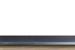 Dessus vide de la table noire de pierre de granit d'isolement sur le backgro blanc photographie stock libre de droits