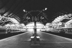 Desterted Train Sation - B&W Grain film effect. Regional Trains waiting for departure in a deserted station. Grain intentional Stock Photo