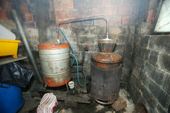 Destillery boilers for making brandy. A view of the distillery boilers for making fruit brandy in an obsolete shed stock images