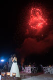 Destination beach wedding fireworks Stock Photo