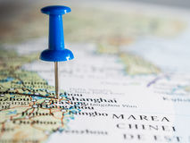 Destination. Blue pushpin showing destination point on a map Royalty Free Stock Image