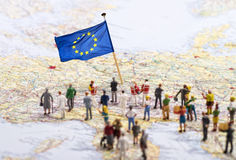 Destination Europe. Europe map with European flag and a large group of figures Royalty Free Stock Images