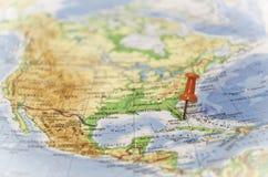 Destination: MIAMI. Miami destination pinned with thumbtack on an old map Stock Photos