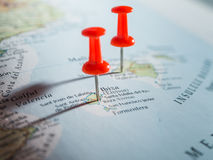 Destination. Red pushpins showing destination point on a map Stock Photography