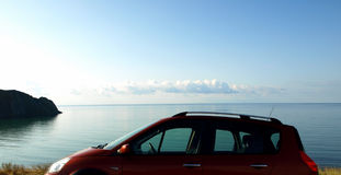 Destination scene. Family car on the sea beach at sunset stock photos Royalty Free Stock Photo