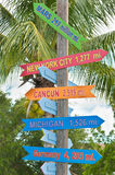 Destination signs with direction and milage. On a wood pole in tropical Marco Island, FL Royalty Free Stock Photography