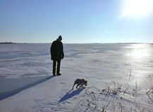 Destination Unknown. Man and best friend, Kindred spirits, Icy dealings, Fuzzy feelings Royalty Free Stock Images