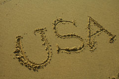 Destination: USA. USA written in sandy beach Royalty Free Stock Images