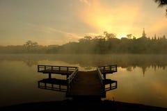 Small bridge reflect on lake at sunrise Royalty Free Stock Images