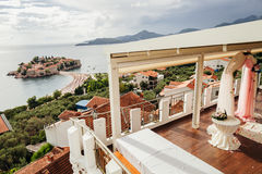 Destination wedding arch with beautifull view. Wedding arch at destination wedding ceremony with view on Sveti Stefan in Montenegro Stock Photos