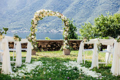 Destination wedding arch with flower decoration Stock Photo
