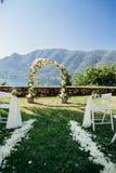 Destination wedding arch with flower decoration Stock Image