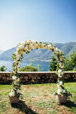 Destination wedding arch with flower decoration Royalty Free Stock Photography