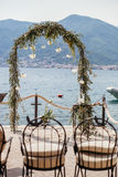 Destination wedding arch with flower decoration and sea view Stock Photo