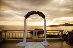 Destination wedding arch. With sea view and mountains at sunset Stock Image