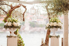 Destination wedding ceremony arch. With sea view and olives at sunset Stock Photos