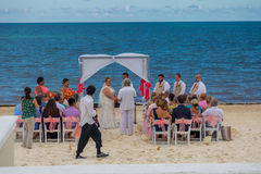 Destination Wedding. A destination wedding ceremony on the beach in Cancun, Mexico royalty free stock images