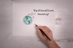 Destination wedding sign sketch of the world with airplane doodle