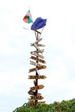 Destinations. A wooden sign pointing in different destinations. Bulgarian and European Union flags on it. Photo taken in Nessebar, Bulgaria Royalty Free Stock Image