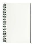 Destinerad tråd eller en spiral - destinerad sketchbook som göras från det isolerade grå färgbrädet på vit bakgrund Royaltyfri Foto