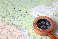 Destino Canadá, mapa del viaje con el compás Imagen de archivo libre de regalías