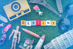 Destiny concept with souvenirs around the world on green grass Stock Image