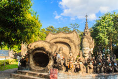 Destiny of life cave: birth, aging, sickness and death at Sala K. Sala Keoku, the park of giant fantastic concrete sculptures inspired by Buddhism and Hinduism Royalty Free Stock Image