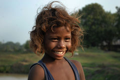 Destiny. A little poor girl smile in the remote village of Bihar-India.A girl child in India is looked as a responsibility and poor families in the rural areas Royalty Free Stock Images