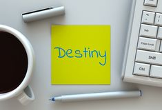 Destiny, message on note paper, computer and coffee. On table royalty free stock image