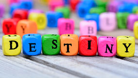 Destiny word on table. Destiny word on wooden table stock photo