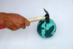 Destroy the earth by human hand. Concept for destroy the earth by human hand on white background, human ruin green planet, is worldwide problem, can make climate Stock Photos