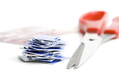 Destroy old credit cards. A pile of cut up credit card pieces next to scissors. Isolated on white background royalty free stock photos