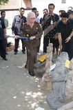 Destroy used evidence. Officer destroying evidence used in criminal action after used in court in solo, central java, indonesia stock photos
